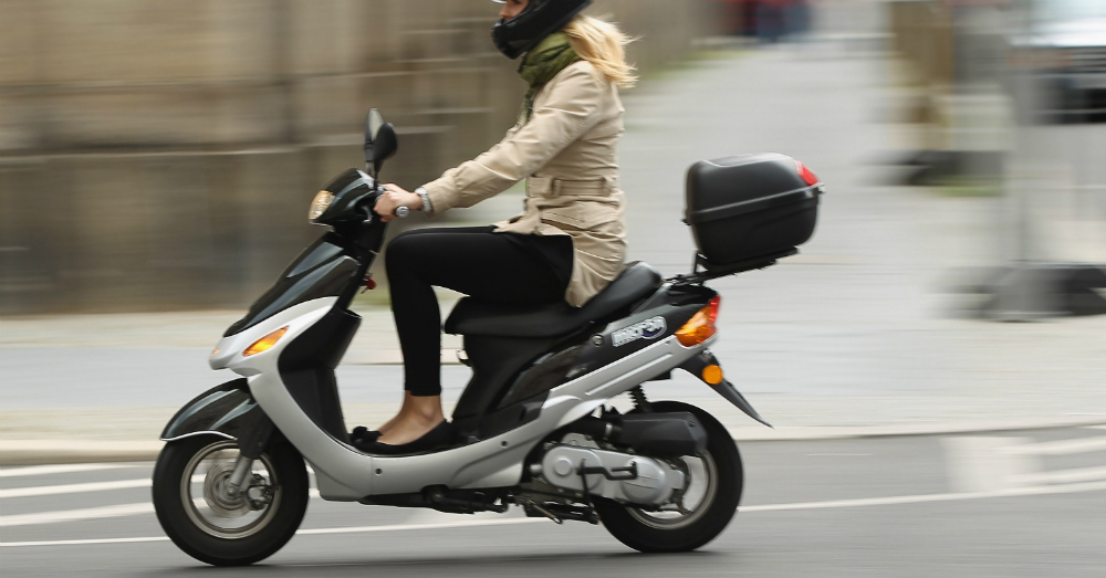 06.10.16 - Woman Riding a Moped